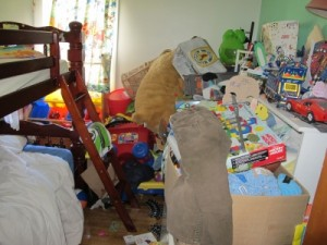 bedroom overflowing with junk