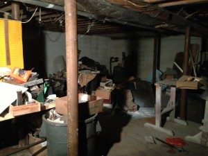 paint, scraps, and debris in basement