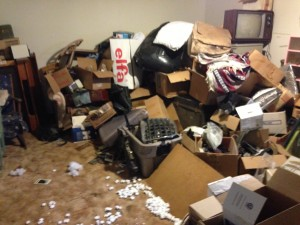 junk and boxes in living room
