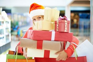 woman with pile of christmas presents