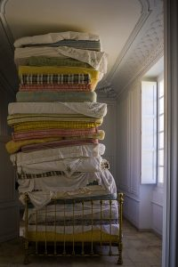 linens piled up on bed