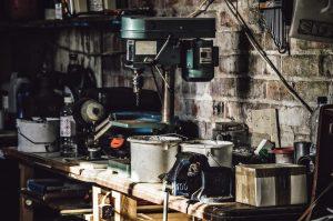 Cluttered tool bench in dark garage